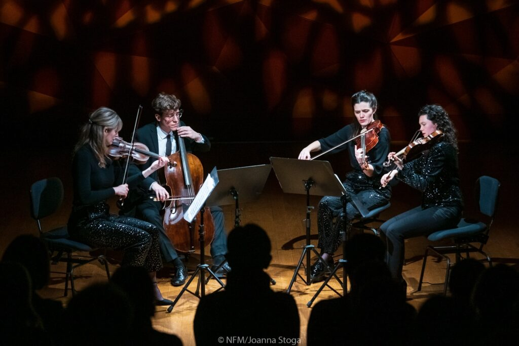 Four musicians playing a concert